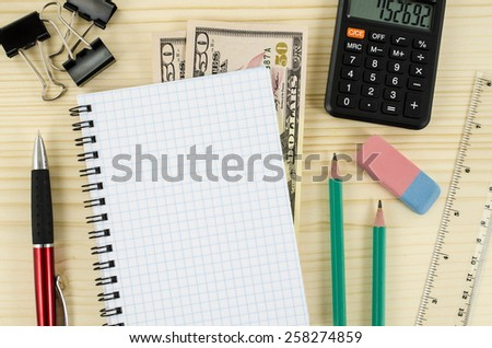 Office, business tools with blank notebook on wooden table - stock photo