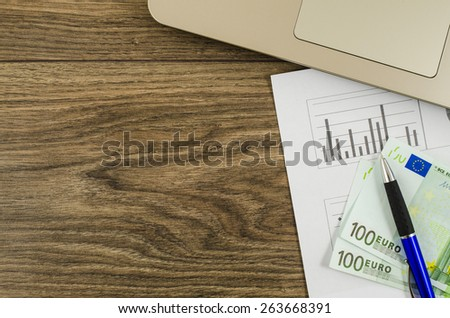 Office, business tools with euro on wooden table - stock photo