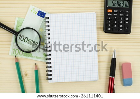 Office, business tools with notebook and euro bills on wooden table - stock photo