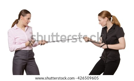 office business workers pulling on a telephone wire in a tug of war.  Isolated on white