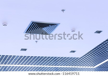 Office ceiling with built-in HVAC fire and systems - stock photo