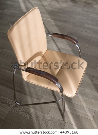Office chair on the wooden floor. Subjects of office interiors. - stock photo