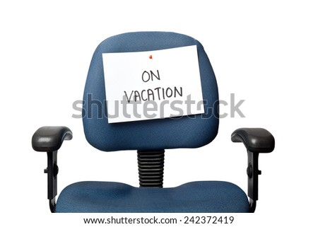 Office chair with a ON VACATION sign isolated on white background  - stock photo