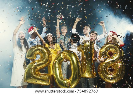 Office christmas party. Group of joyful colleagues having fun at new year celebration. Happy smiling people holding golden number balloons, 2018 year symbol. Greeting card for co-workers mockup