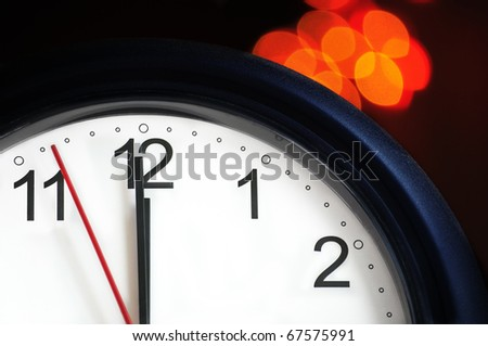 Office clock about to show midnight - few seconds to New Year - stock photo