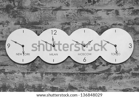 Office Clock with world on black and white background - stock photo
