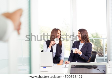 Office coffee break with two female