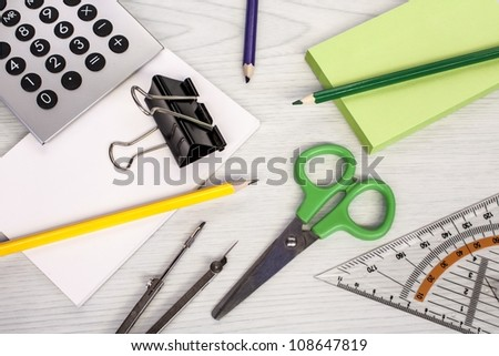 office composition, calculator, pencils, scissors, measure equipment and notepads - stock photo