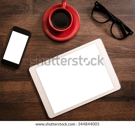 Office concept with blank screens on tablet pc and smart phone - stock photo