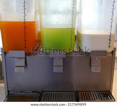 Office cooler with orange juice , guava juice , milk  - stock photo