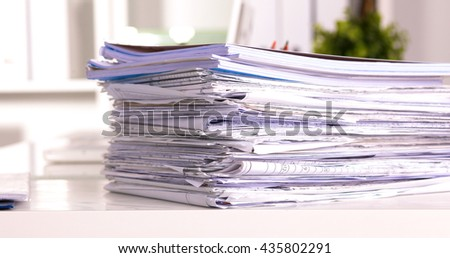 Office desk and a bundle of documents