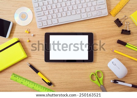 Office desk mock up template with tablet and office items. View from above - stock photo