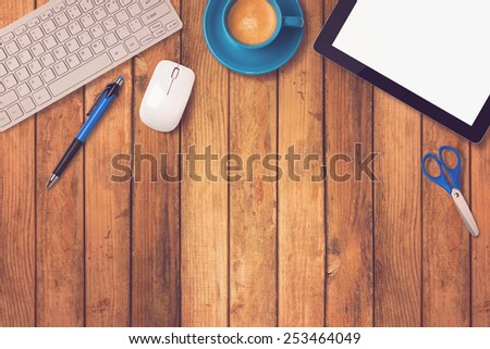 Office desk mock up template with tablet, keyboard and coffee on wooden background - stock photo