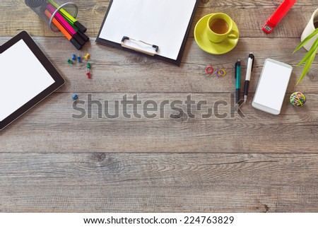Office desk mock up template with tablet, smart phone and cup of coffee. View from above with copy space - stock photo