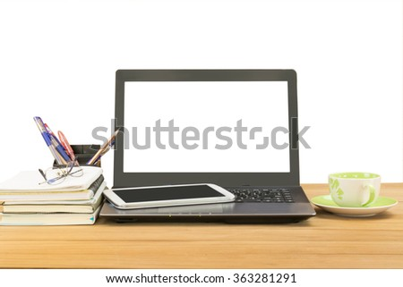 office desk,notebook computer,tablet,coffee cup,book,pen,pencil on wooden table over white background,selective focus at monitor - stock photo