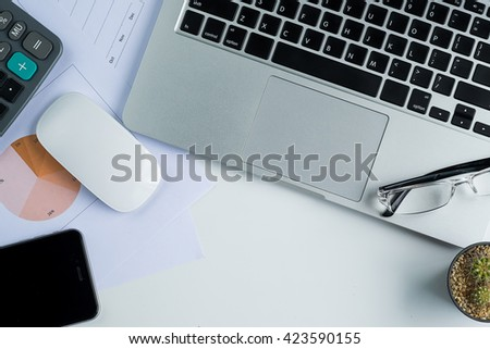 Office desk table with computer,calculator,document.Top view with copy space - stock photo