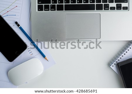 Office desk table with computer,document and supplies.Top view with copy space - stock photo