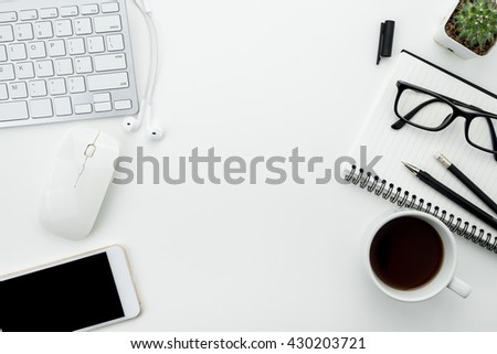 Office desk table with computer mouse, keyboard, cup of coffee and supplies. Top view with copy space. - stock photo