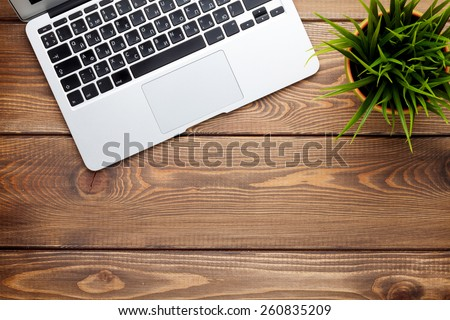 Office desk table with laptop computer and flower. Top view with copy space  - stock photo