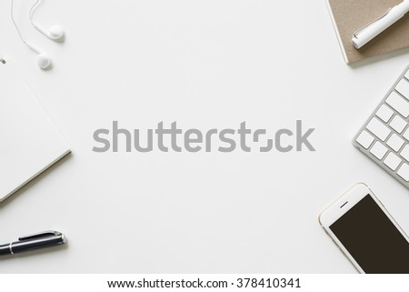 Office desk table with office supplies and notepaper. Top view with copy space - stock photo