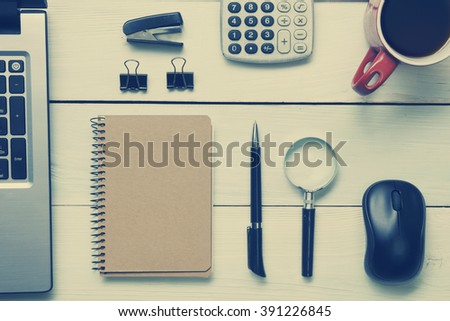 Office desk table with supplies and coffee cup. Top view. Copy space for text - stock photo
