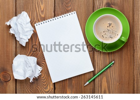 Office desk table with supplies and coffee cup. Top view with copy space - stock photo
