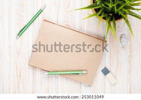 Office desk table with supplies and flower. Top view with copy space - stock photo