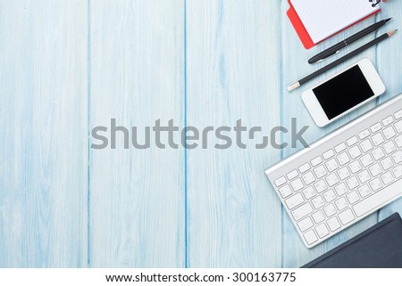 Office desk table with supplies, smartphone and computer. Top view with copy space - stock photo