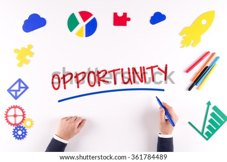 Office desk with a single word OPPORTUNITY - stock photo