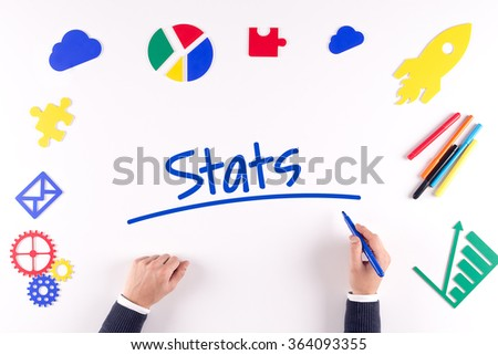 Office desk with a single word Stats - stock photo