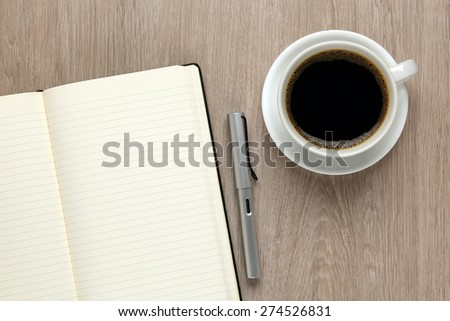 Office desk with blank paper - stock photo