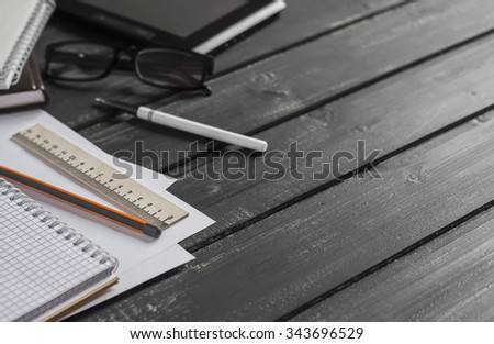 Office desk with business objects - open notebook, tablet computer, glasses,  ruler,  pencil,  pen. Free space for text. Office workplace - stock photo