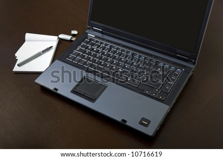 office desk with computer pen usb drive and notebook