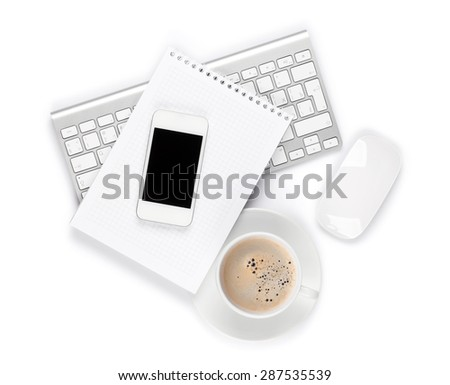 Office desk with computer, supplies and coffee cup. Isolated on white background - stock photo