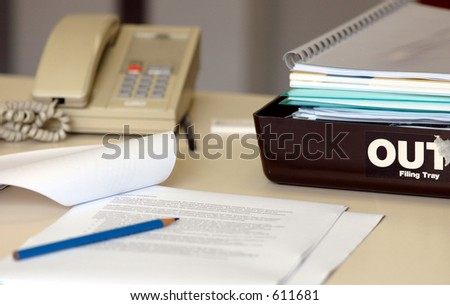Office desk with Out tray - stock photo