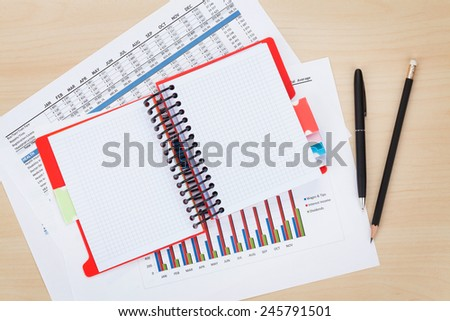 Office desk with reports and blank notepad. View from above - stock photo