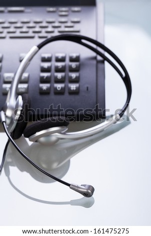 office desk with telephone and headset objects break work - stock photo