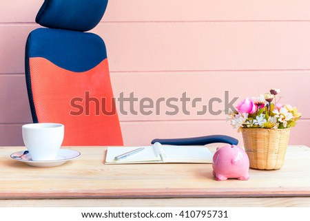 Office desk workplace with open book  on the wooden table. - stock photo