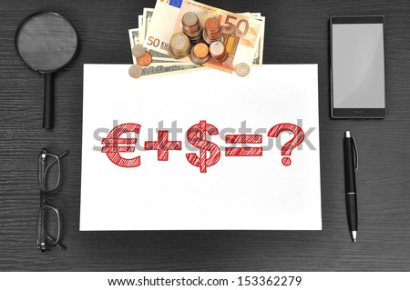 Office desktop, paper with business formula and money - stock photo