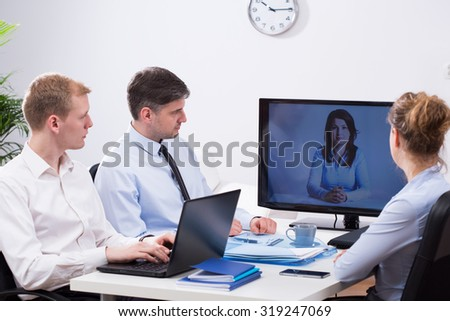 Office employers are talking during video conference - stock photo