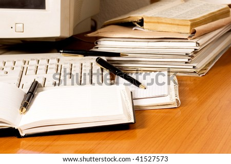 Office equipment on desk with pencils and documents - stock photo
