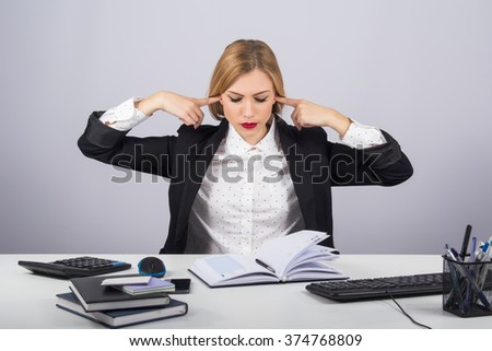 Office, finances, internet, business, success and people concept- Stressed businesswoman covering her ears with hands on gray background