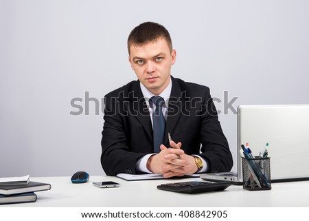 Office, finances, internet, business, success concept-Business man working with documents and laptop on a grey background - stock photo