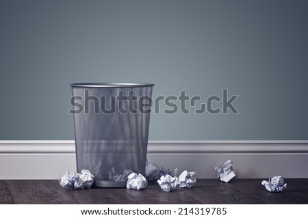 office garbage near metal basket - stock photo