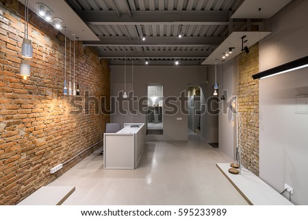 loft style office. office in a loft style with brick and gray walls there are many different glowing