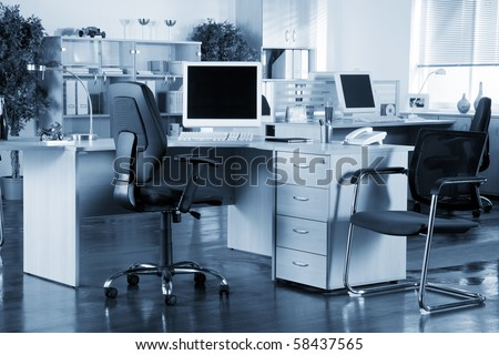 Office interior with blue tint - stock photo