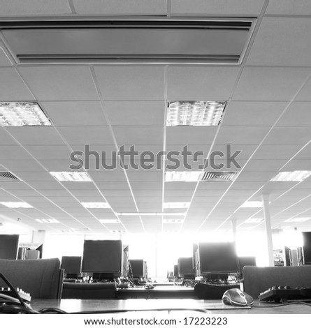 Office interior with computers - stock photo