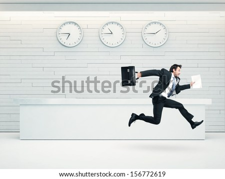 office interior with running businessman - stock photo
