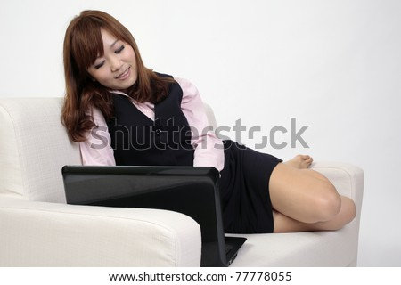 Office lady uses notebook computer.