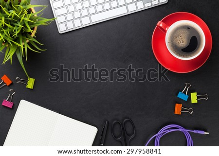 Office leather desk table with computer, supplies, coffee cup and flower. Top view with copy space - stock photo